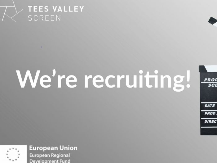 black clapperboard on grey background with white text